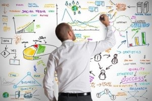 shutterstock_124904123- free  image of man on whiteboard - compressed